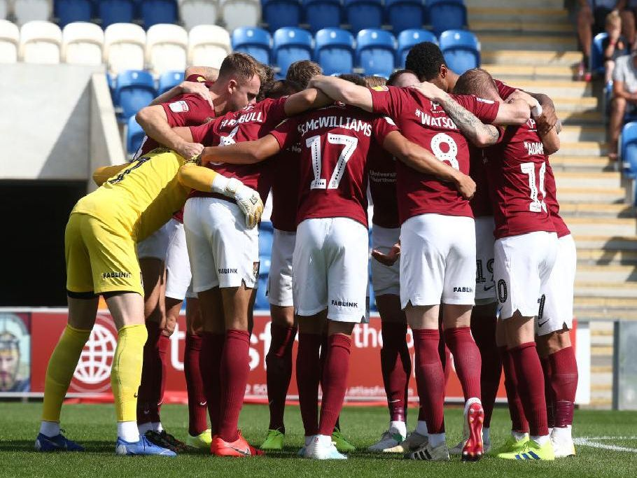 Cobblers have their usual pre-match huddle. Pictures: Pete Norton