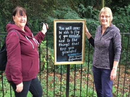Buddies of Beckets volunteers Joy Ormond and Sue Ward with the poem blackboard in the park