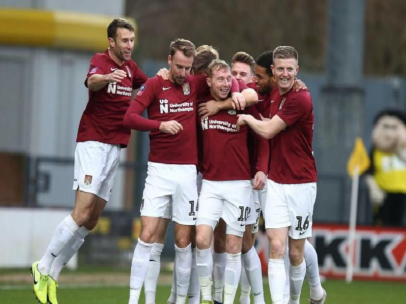 Nicky Adams gets the congratulations after steering the Cobblers into an early lead at Burton on Sunday. Pictures: Pete Norton