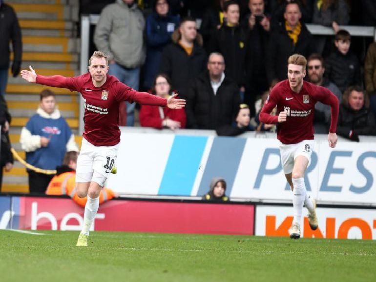 Nicky Adams celebrates after firing the Cobblers into a 1-0 lead at Burton (PIctures: Pete Norton)