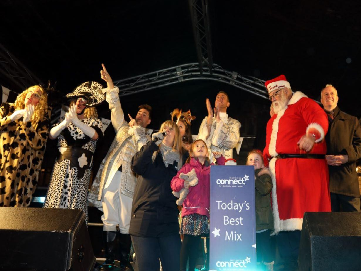 Mia and Bella Pettit switch on the lights (Picture: Alison Bagley)
