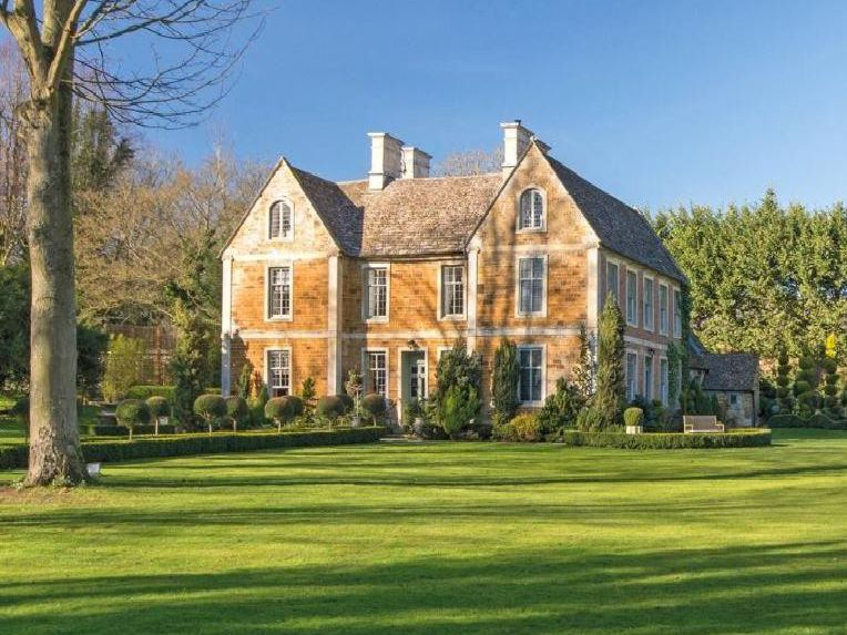 The Dower House at Rushton is currently owned by the founder of a high street clothing brand - but that could be about to change! It has eight bedrooms, a media room and a swanky converted basement.
