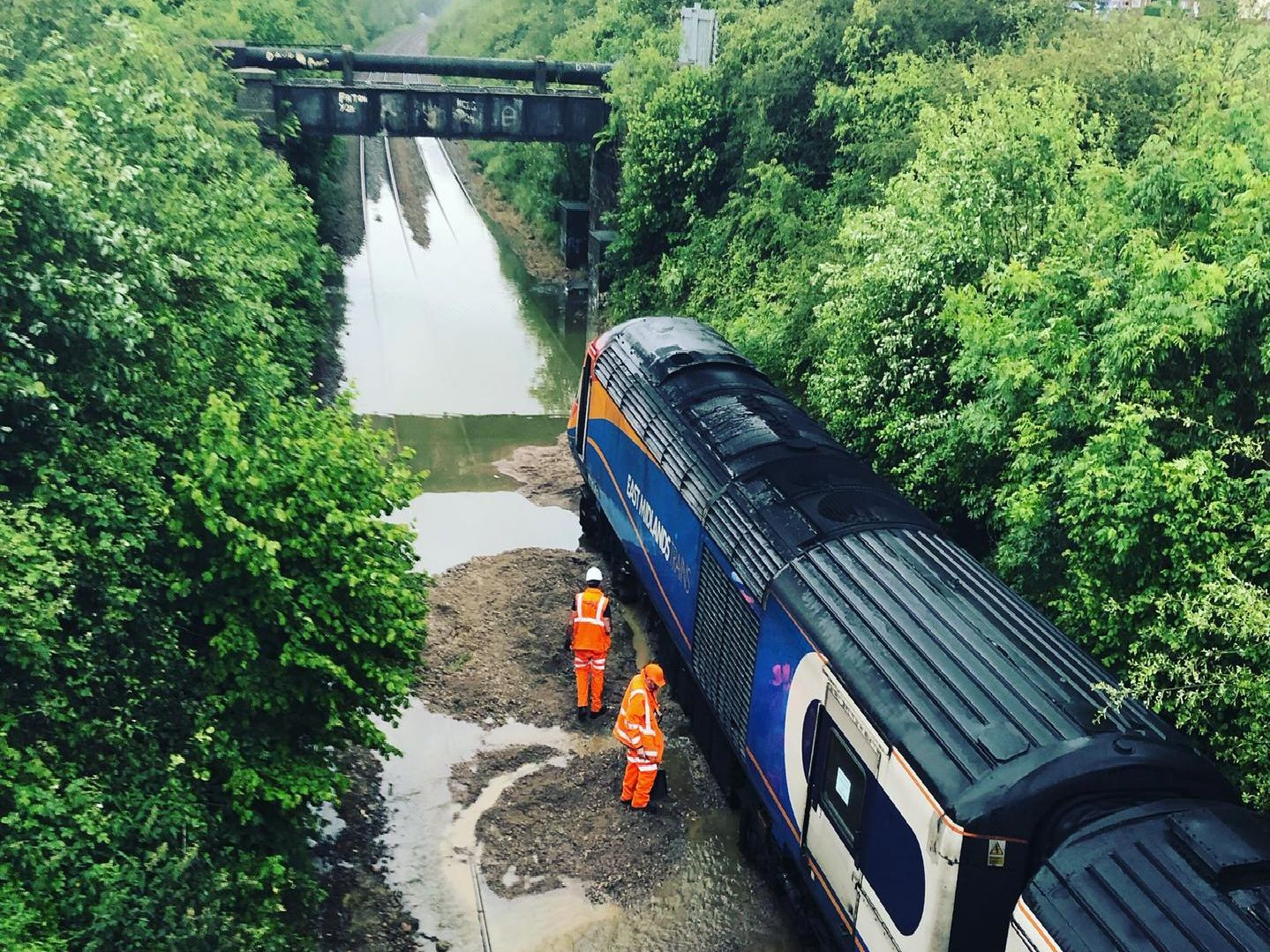Network Rail contractors try to dig out the train