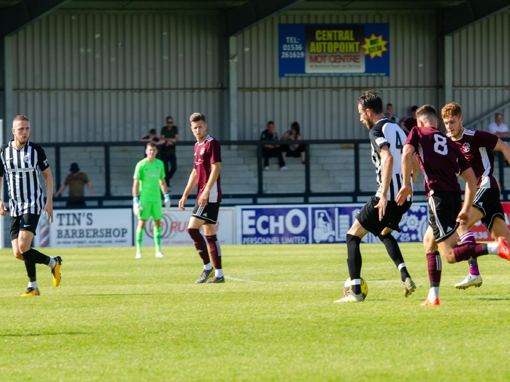 Action from Corby Town's 4-0 victory over Holbeach United