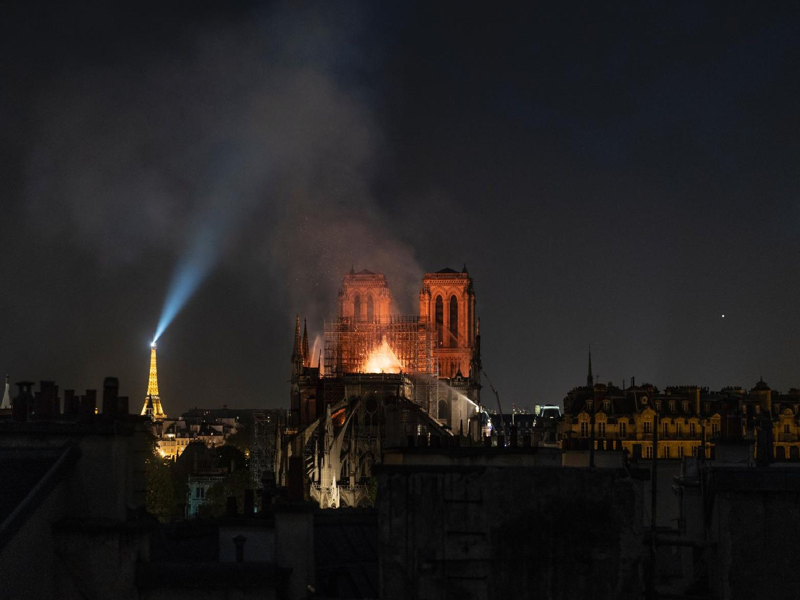 Smoke and flames rise from Notre-Dame Cathedral on April 15, 2019.