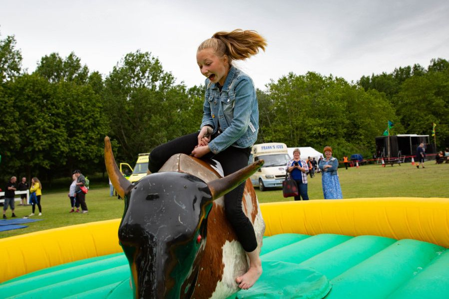Bretton Festival. Anastasia (11) rides the mechanical bull, not for long.,'Bretton, Peterborough'07/07/2019. 'Picture by Terry Harris / Peterborough Telegraph. THA