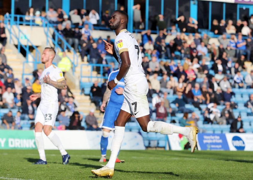 Mo Eisa celebrates his goal from the penalty spot for Posh at Gillingham. Photo: Joe Dent/theposh.com.