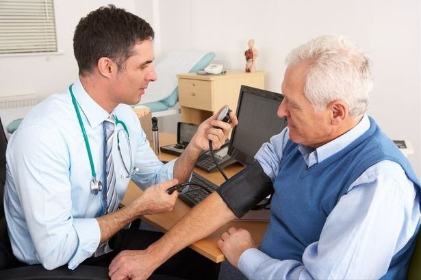 A GP seeing a patient