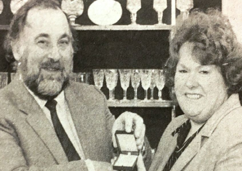 Mr Alan Stracey presents Mrs Maureen Woolridge with a necklace as first prize in a Times competition in 1985.