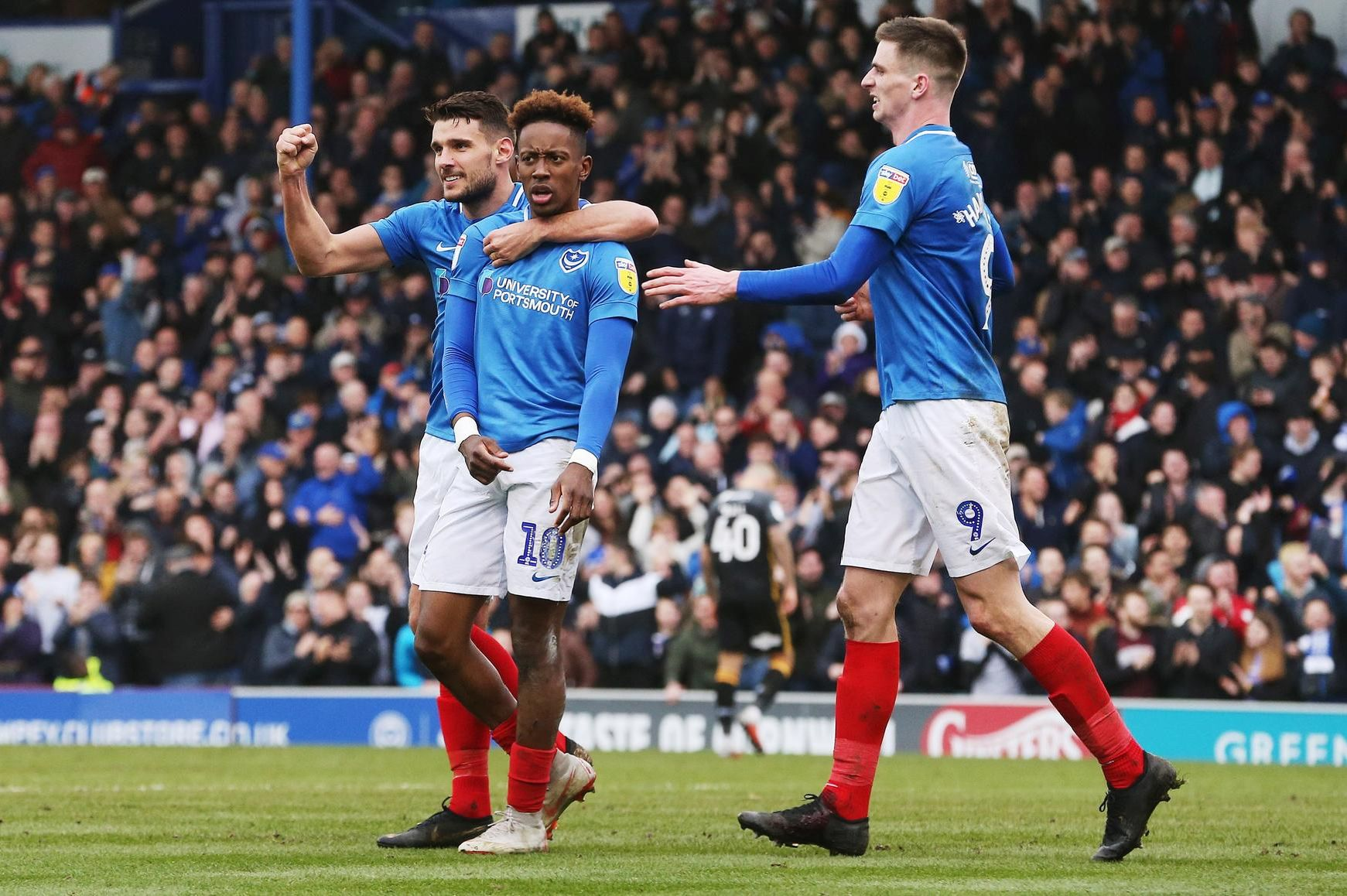 Pompey celebrate Jamal Lowe's goal against Bradford - two minutes after Hope Akpan had netted for the visitors. Picture: Joe Pepler