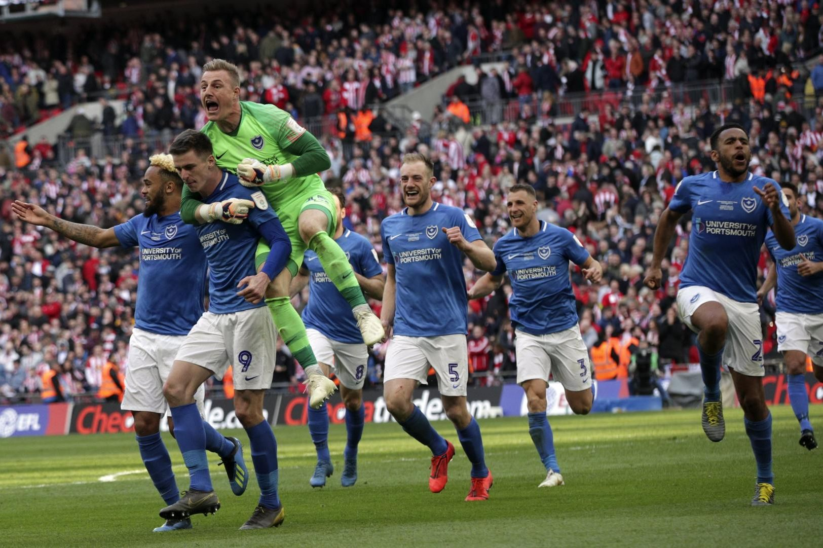 Pompey celebrate their Checkatrade Trophy triumph at Wembley. Picture: Barry Zee