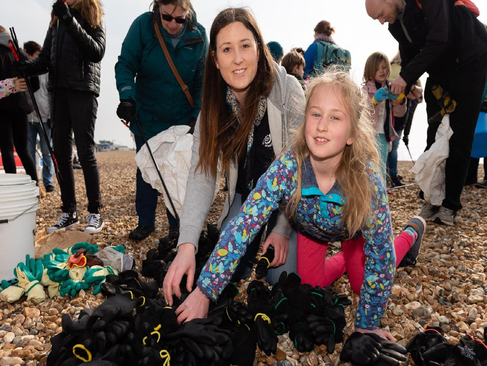 Big Spring Beach Clean - Natasha Parker and her daughter Evelyn Derrick (age 8) from Plastic Free Hayling prepare'ing safety gloves. (060419-001)