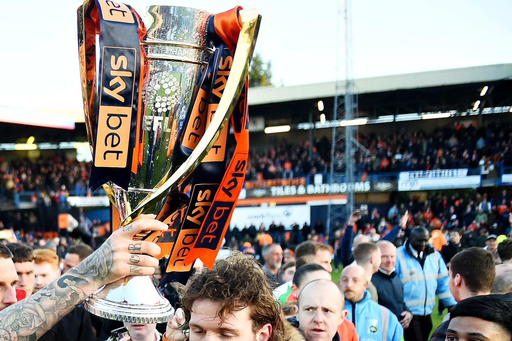 LUTON, ENGLAND - MAY 04: Glen Rea and teammate Sonny Bradley of Luton Town celebrate their side winning the league after the Sky Bet League One match between Luton Town and Oxford United at Kenilworth Road on May 04, 2019 in Luton, United Kingdom. (Photo by Nathan Stirk/Getty Images)