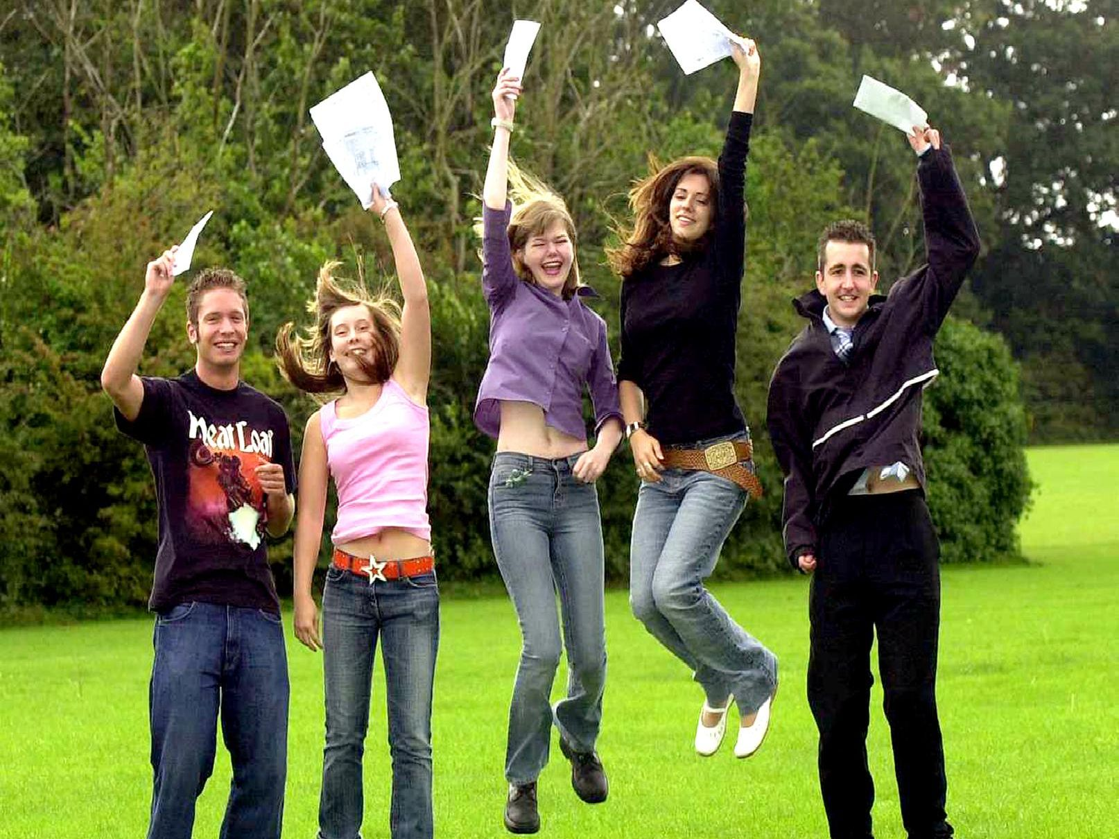 (left to right) Richard Noice (18), Jodi Poulter (18), Charlotte Jones (18), Vikki Farrer (18), and Lee Vaughan (18) celebrate their A-Level results at Fareham College. Picture: Malcolm Wells ( 000-0064 )