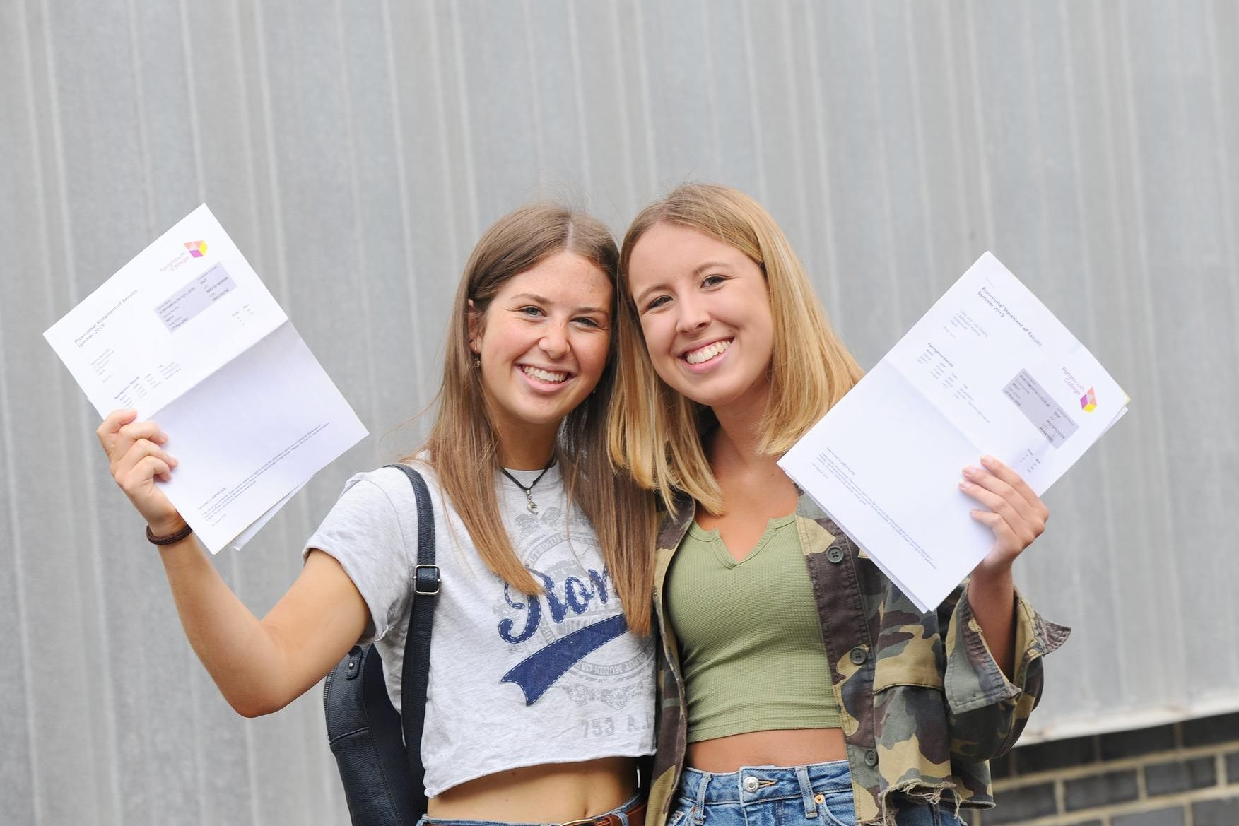 Sabine Newman (18) who got three A's and Libby Gissing (18) who got two A's and one A*. Picture: Sarah Standing (150819-5484)