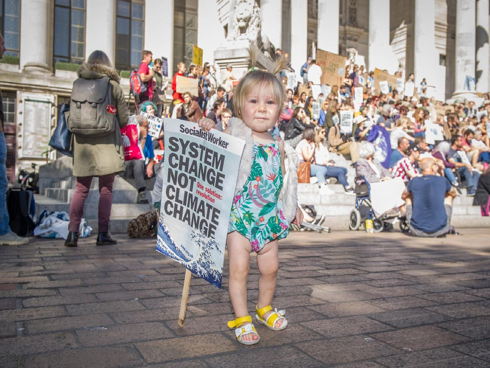 One-year-old Texas Dollani at the protest. Picture: Habibur Rahman