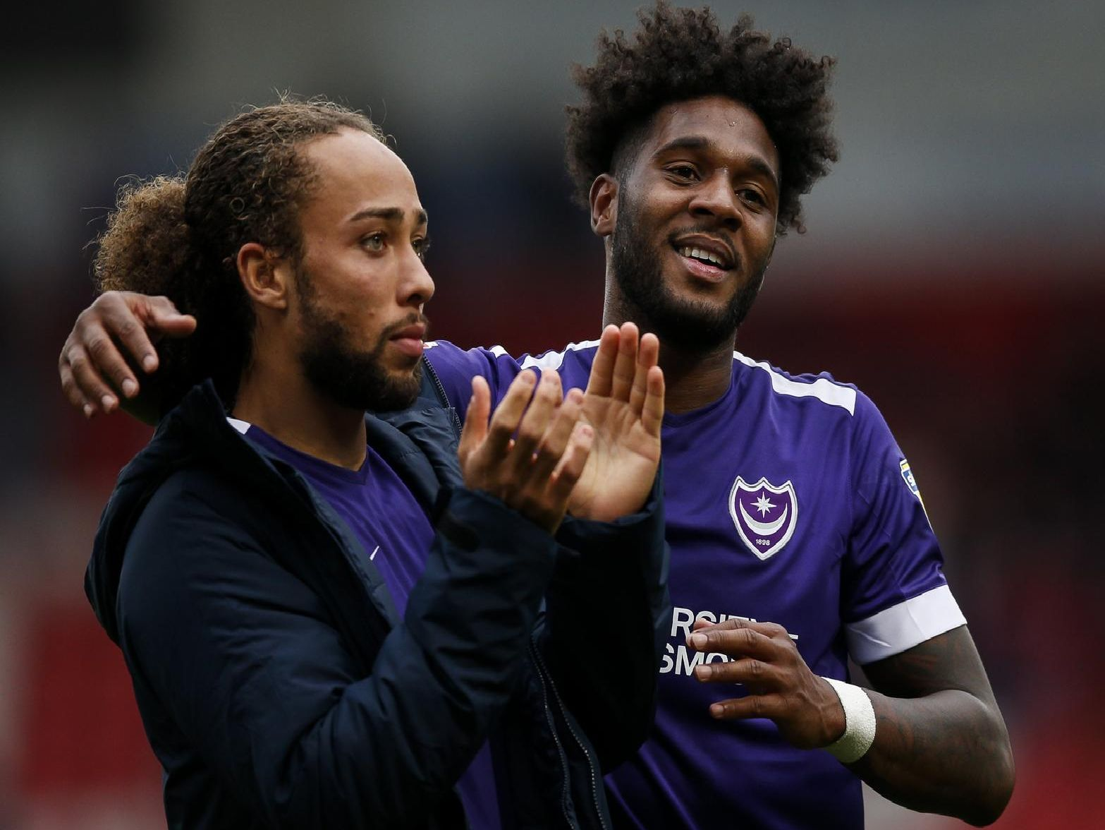 Ellis Harrison of Portsmouth celebrates with Marcus Harness of Portsmouth at full time of the Sky Bet League One match between Doncaster Rovers and Portsmouth at Keepmoat Stadium on October 5th 2019 in Doncaster, England. (Photo by Daniel Chesterton/PinPep)