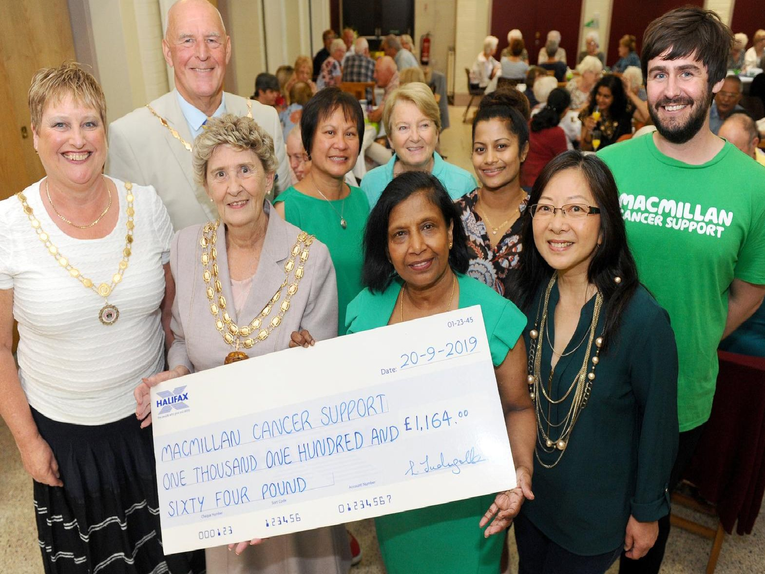 A 'Grand Tea Party' took place inside St Philip Howard church hall in Fareham, on Friday, September 20, as part of Macmillan Cancer Support's annual tea party campaign. 'Pictured is: (back l-r) Deputy Mayor of Fareham Mike Ford, Mary May, Liz Wiltshire, Anusha Thilakarathna and Ryan Howarth, fundraising manager for Macmillan Cancer Support with (front l-r) Anne Ford, deputy Mayoress of Fareham, the Mayor of Fareham Pamela Bryant, Lorinda Tudugalle, organiser and Jenny Wong.'Picture: Sarah Standing (200919-7059)