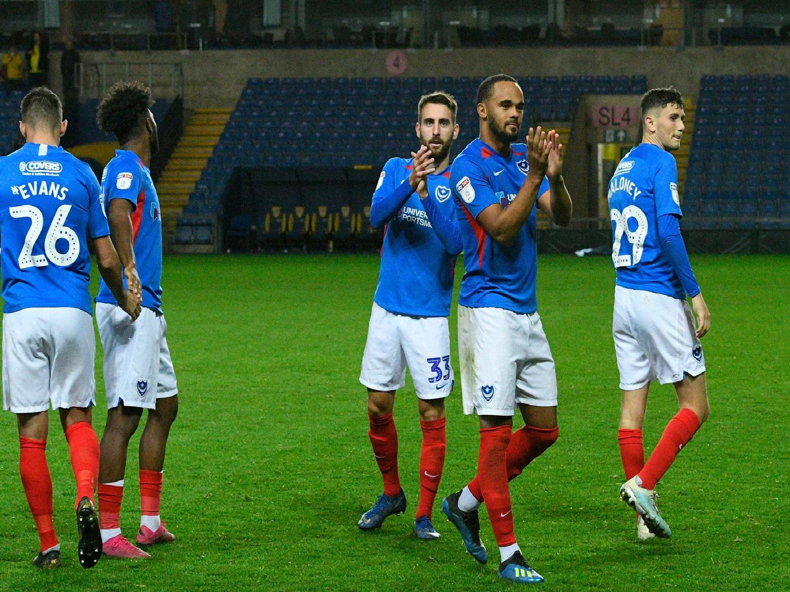 Portsmouth players including Ellis Harrison and Ben Close applauds the fans after the the team won the penalty shoot out at full time during the Leasing.com EFL Trophy match between Oxford United and Portsmouth at the Kassam Stadium, Oxford, England on 8 October 2019.
