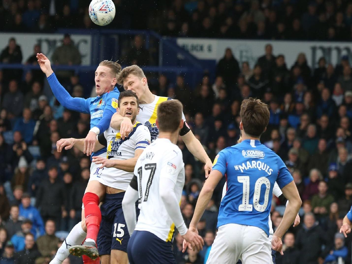 Portsmouth's Ronan Curtis battles for the ball
