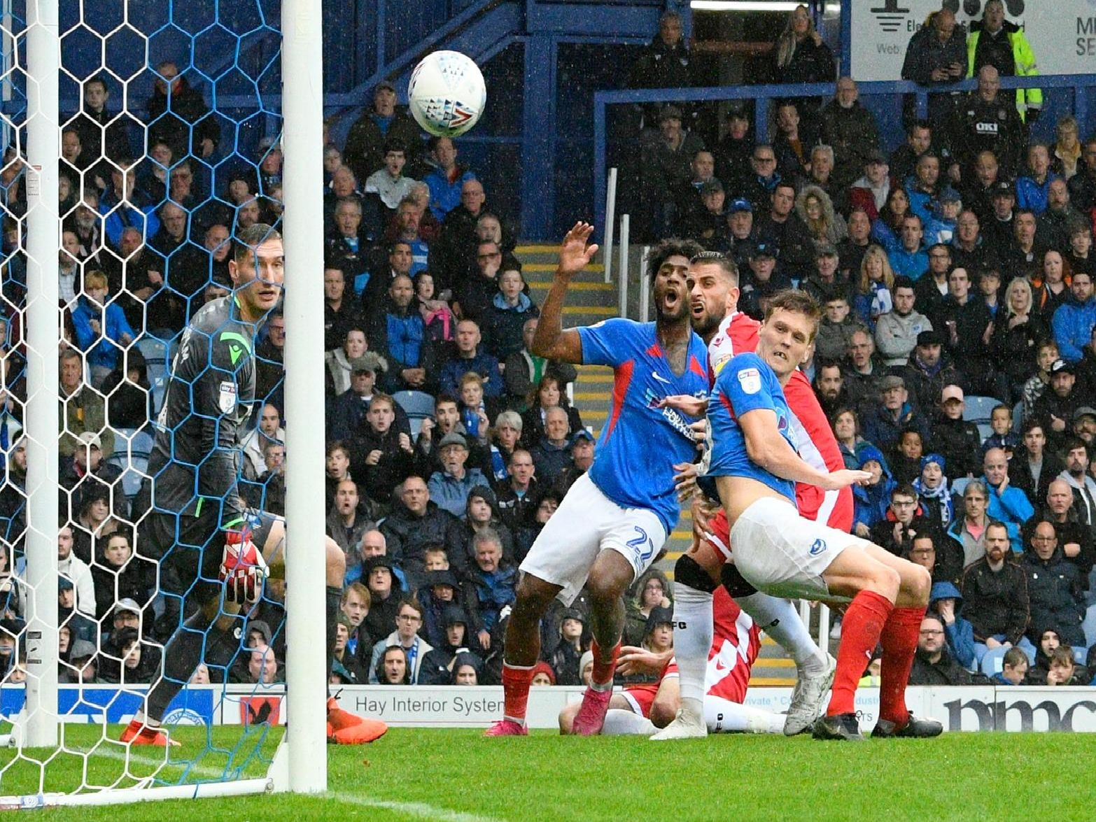 Sean Raggett (20) of Portsmouth heads a shot at goal which hits the post during the EFL Sky Bet League 1 match between Portsmouth and Gillingham at Fratton Park, Portsmouth, England on 12 October 2019.