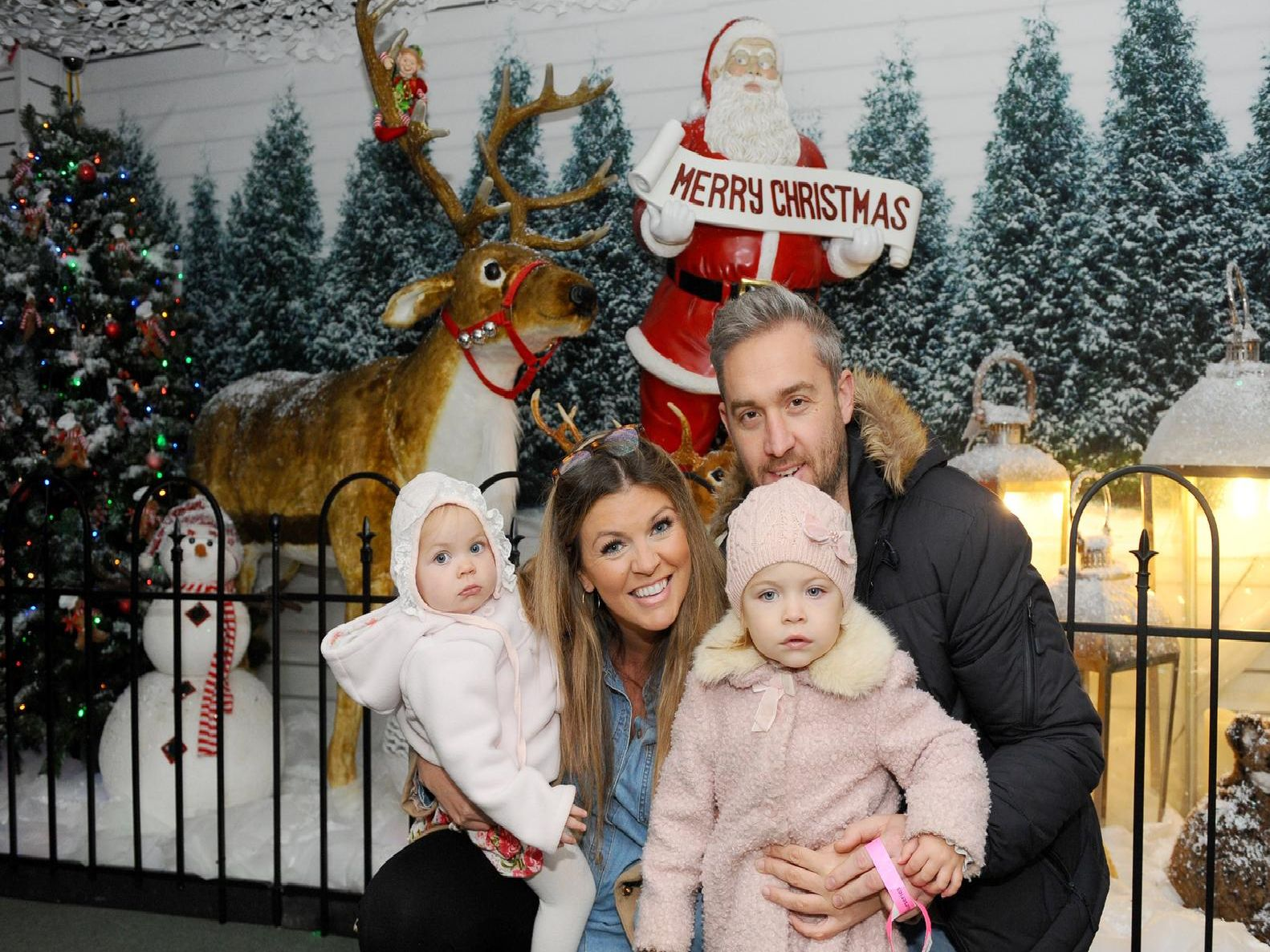 Santa's Woodland Walk is now open at Keydell Nurseries in Horndean. Pictured is: Hayley and Lee Wight with their daughters (l-r) Annora (1) and Remirose (2). Picture: Sarah Standing (141119-2009)
