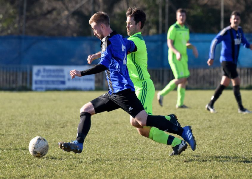 Action from Hollington United's 2-0 win at home to AFC Ringmer