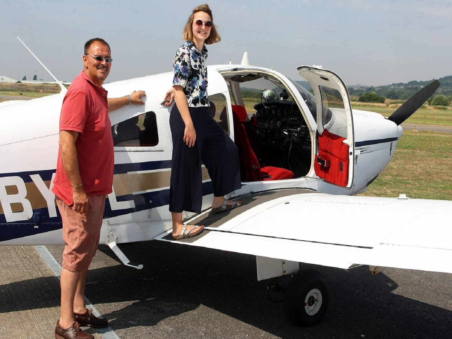 Pilot Kit Maharajh with reporter Isabella Cipirska ahead of a flight from Shoreham Airport to Brighton in July