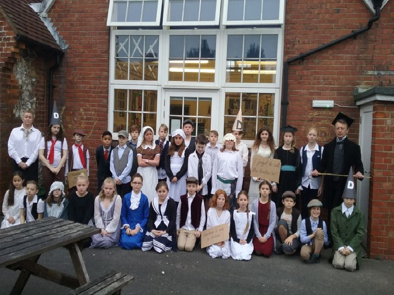Pupils from years five and six in their period costumes with their Victorian teachers
