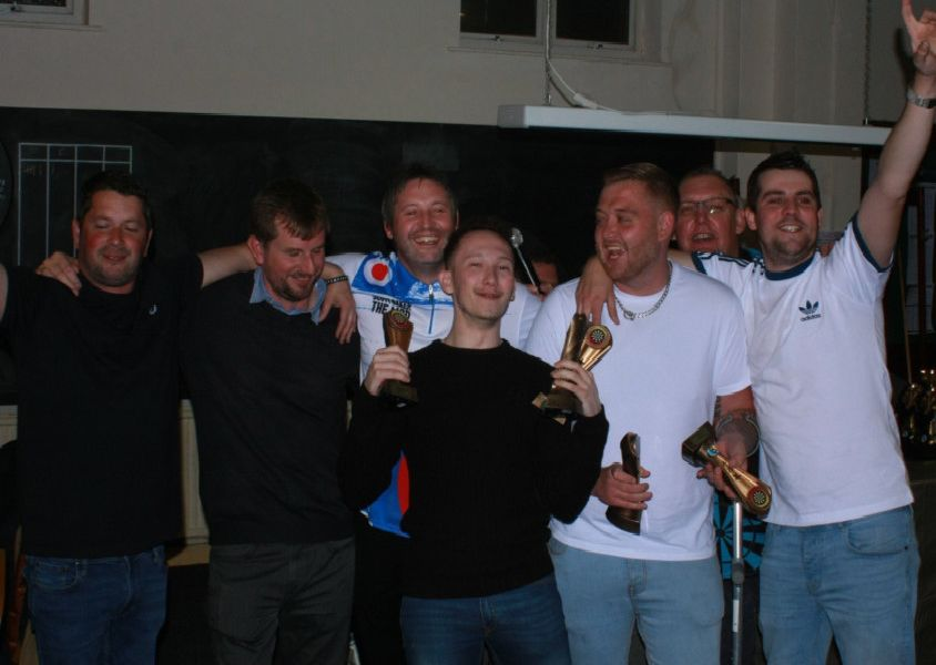 Web Signs Division One winners Seaview Next Tuesday celebrate.