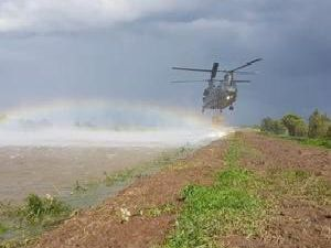 A RAF Chinook helicopter has spent another day reinforcing the work done plugging the gap in the River Steeping.