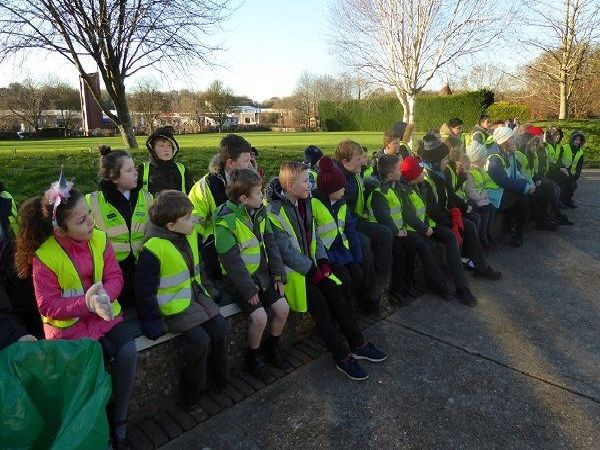 Pupils from Holy Cross CEP School and volunteers from Brighter Uckfield tackle the town's litter