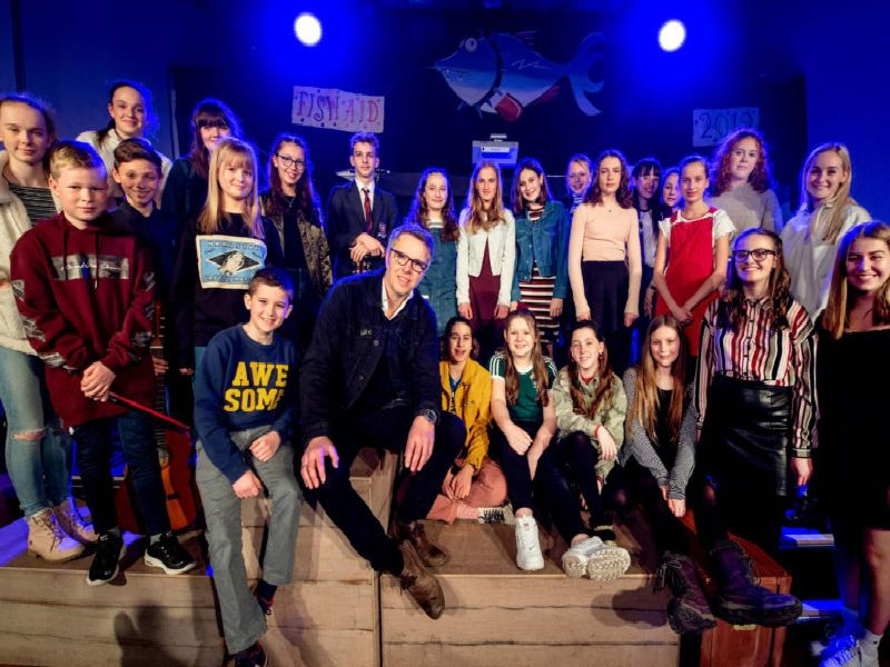 Musician Rob Green, drummer in the band Toploader, with the pupils from Lewes Old Grammar School that performed at the concert.