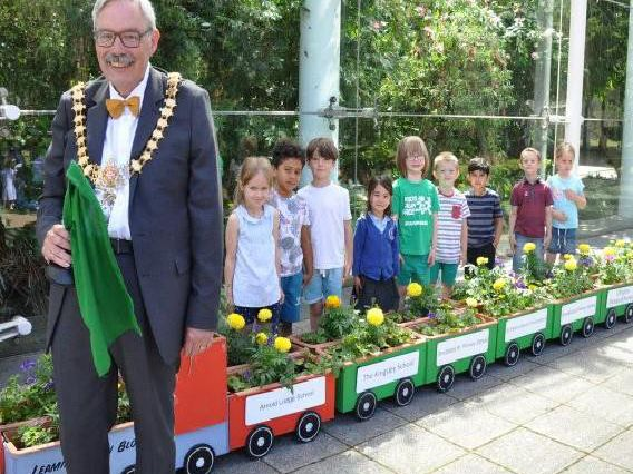 Leamington Mayor, Cllr Bill Gifford, launches the Leamington in Bloom Floral Train with some of the school children from Clapham Terrace Primary School, who grew the flowers.
