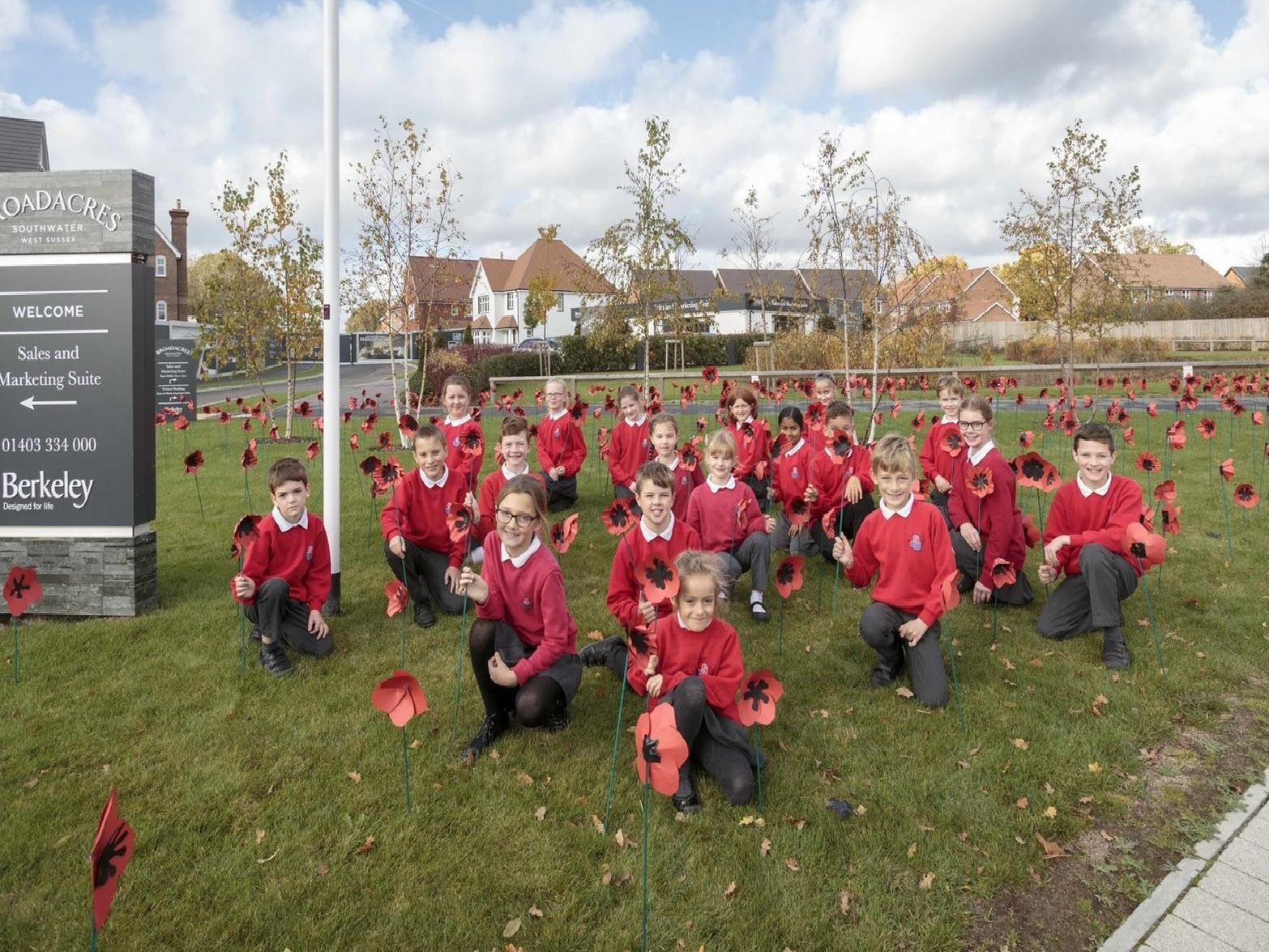 A beautiful display of 480 cardboard hand-crafted poppies with bamboo stalks, made by children from Southwater Junior Academy was unveiled at Berkeley Homes' Broadacres development in Southwater on Thursday November 8