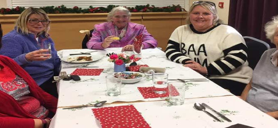 Volunteers with their friend at the Village Friends Christmas lunch. Picture: Meg Brackley