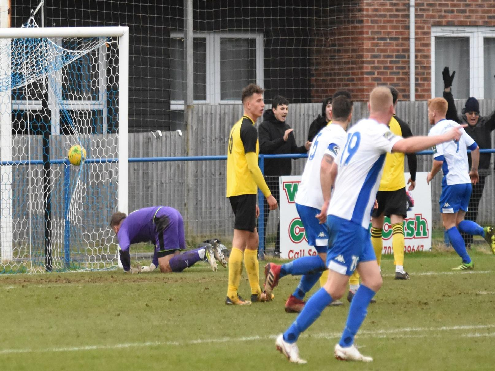 Alex Laing's header nestles in the net.