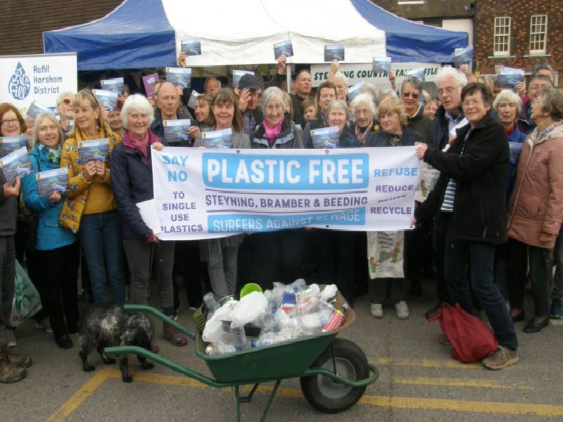 Supporters showing their pledge cards at the launch of Plastic Free Steyning, Bramber and Beeding