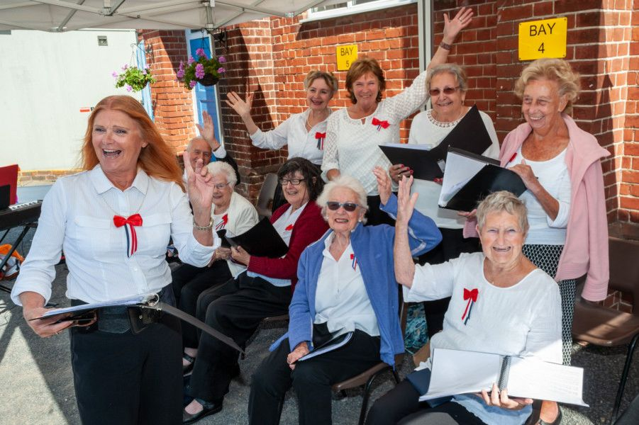 Members of the Age UK Choir entertain visitors at the We Will Meet Again event