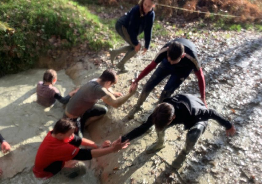 More than 100 year-11 students and 18 staff from Durrington High School tackled the challenging assault course at Henfold Lakes in Dorking