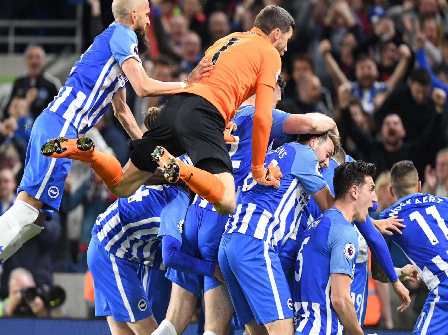 Albion celebrate Pascal Gross's goal which sealed Premier League survival against Manchester United. Picture by PW Sporting Photography