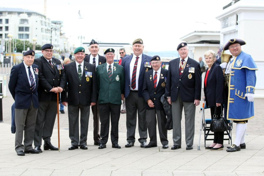 Military veterans arrive by taxi to enjoy a day out in Worthing