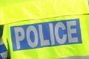 Police are appealing for witnesses after a cyclist was  beaten unconscious  and robbed in a Crawley street