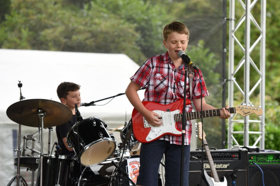 Funday Sunday''Rotary Club of Horsham Funday Sunday.''Pictured are Lightning on the main stage. Band member Sam Holder (10) with brother Ben Holder on drums. ''Horsham Park, Horsham, West Sussex.''Picture: Liz Pearce''07/07/2019''LP190711 SUS-190807-082058008