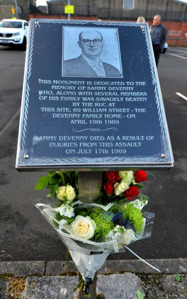 Flowers placed, by family members, at the memorial to Sammy Devenny, on William Street, on Wednesday evening last. DER2919GS-034