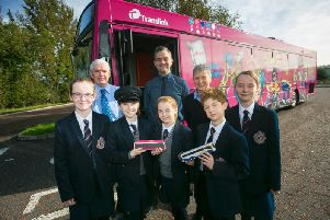 Translinks new Safety Bus can visit approximately 350 schools, or up to 25 thousand students, across Northern Ireland each academic year. Pictured at Aquinas Diocesan Grammar School in Belfast are Year 8 student Sarah McWilliams; Kevin Wallace, Safety Bus; Year 8 pupil Hannah Wilson; Sean McGreevy, Metro Falls Service Delivery Manager; Erin Watson, Year 8 student ; Susan ONeill, Safety Bus; and Year 8 students Oscar Feron and Kate McWilliams