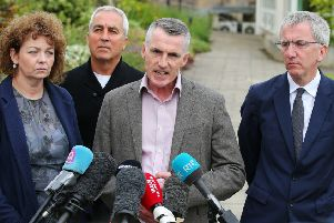 SF chairperson Declan Kearney (centre) with, from left, Car�l N� Chuil�n, Pat Sheehan and M�irt�n � Muilleoir at a SF press conference