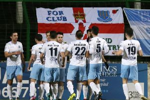 Ballymena players celebrate Cathair Friel's penalty