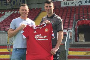 Kevin Braniff and Johnny Flynn celebrate signing for Portadown on two-year deals.