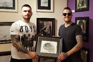 Fergie (right) being presented with the art by Carl.
